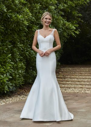 A striking mermaid style, with a sweetheart neckline, illusion hand beaded shoulder straps, hand beaded waist detail and finished with an illusion hand beaded back detail.